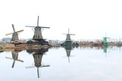 A CLASSIC WINDMILL  REFLECTING AT THE CALM WATERS OF ZAANSE SCHANS royalty free stock photos