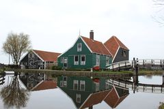 A HOUSE REFLECTING AT THE CALM WATERS OF ZAANSE SCHANS royalty free stock photo