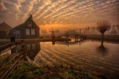 Zaanse Schans at Sunrise. Golden hour striped sky over Zaanse Schans, a historical neighbourhood of Zaandam, North Holland royalty free stock photos