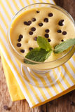 Zabaione cream with chocolate drops close up in a glass. vertica Royalty Free Stock Images