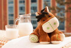 Zabawka i mleko Zdjęcie Royalty Free