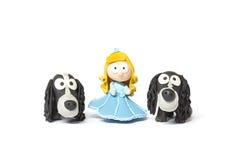 Zabawkarska lala z psami na bielu Zdjęcia Royalty Free