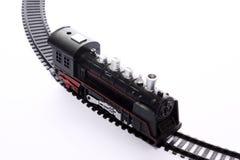 Zabawkarska lokomotywa na poręczach obraz royalty free