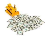 Zabawkarski buldożer i pieniądze Obraz Stock
