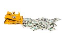 Zabawkarski buldożer i pieniądze Zdjęcie Royalty Free