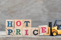 Zabawkarski forklift chwyta listu blok E uzupełniać słowo gorącą cenę zdjęcia stock