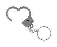 Zabawkarski kajdanki keychain otwierający na białym tle Zdjęcia Stock