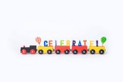 Zabawkarski pociąg z kolorowymi listami na odgórny ustawionym w słowa celebrat Zdjęcia Royalty Free