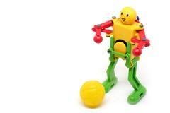Zabawkarski robot bawić się futbol Zdjęcie Royalty Free