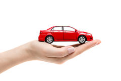 Zabawkarski samochód na żeńskiej ręce na białym tle obraz stock