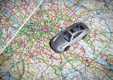 Zabawkarski samochód na drogowej mapie Obraz Stock