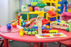 Zabawki na stole w children playroom Zdjęcie Royalty Free