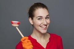 Zabawy cleaning pojęcie dla atrakcyjnej 20s dziewczyny Zdjęcia Royalty Free