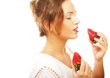 Zabawy kobieta z truskawką Zdjęcia Royalty Free