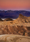 Zaberski Point - Death Valley National Park. Man standing on rocks overlooking Zaberski Point at Death Valley National Park at sunrise Royalty Free Stock Photo