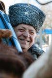 Senior in hat. ZABOLOTTIA, UKRAINE - 20 January 2009: Man in papakha at local market in winter Royalty Free Stock Photography