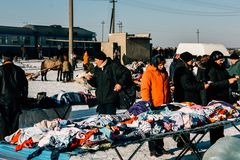 People on the local market. ZABOLOTTIA, Volyn / UKRAINE - January 20 2009: Shopping tents and people on the local market in winter Royalty Free Stock Image