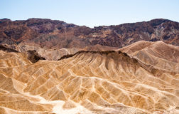 Zabriskie Point. Beautiful unbelievable golden waves of rocks surrounded by the colorful mountains Royalty Free Stock Photos
