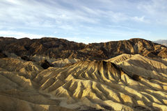 Zabriskie Point, Death Valley National Park. Sky and rock formation Royalty Free Stock Photography