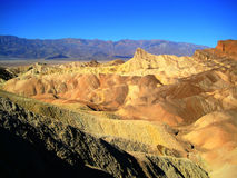 Zabriskie point with enhanced colours. Zabriskie Point is a part of Amargosa Range located east of Death Valley in Death Valley National Park in California Stock Photo