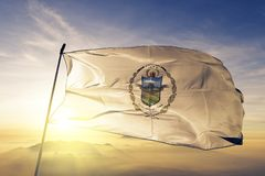 Zacatecoluca city and La Paz Department of El Salvador flag textile cloth fabric waving on the top sunrise mist fog. Beautiful royalty free stock photography