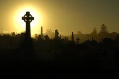 zachód słońca na cmentarz Zdjęcia Stock