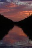 zachód słońca nad wodą Obrazy Royalty Free