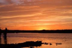 zachód słońca nad wodą Zdjęcie Royalty Free