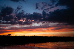zachód słońca nad wodą Fotografia Royalty Free