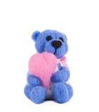 Zacht stuk speelgoed teddy met hart Stock Foto's