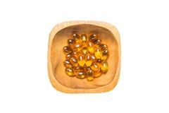 Zachte gelatinecapsule in houten kom Royalty-vrije Stock Foto