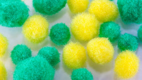 Zachte gele en groene pompoms Stock Afbeeldingen