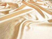 Zachte gouden satijnachtergrond Stock Foto's