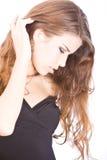 Zachte jonge vrouw wat betreft haar Stock Fotografie
