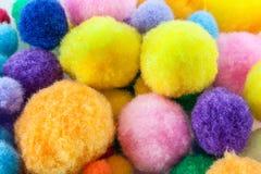 Zachte kleurrijke pompoms Stock Foto