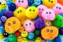 Zachte kleurrijke pompomsgezichten Royalty-vrije Stock Foto