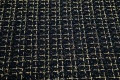 Zachte zwarte stof met een lovertjeplaid Stock Afbeeldingen