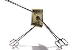 zaciśnij medyczny pieniądze Fotografia Stock