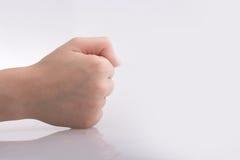 Zaciskająca pięści ręka na białym tle Obraz Stock