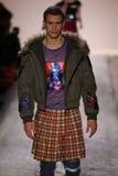 Zack Riddle walks the runway at the Jeremy Scott show. NEW YORK, NY - FEBRUARY 10: Zack Riddle walks the runway at the Jeremy Scott show during New York Fashion Stock Image