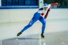Zaczynać przyśpieszenie atlety prędkości łyżwiarki Zdjęcia Stock