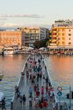ZADAR, CRO, AUGUST 1: people crossing bridge leading to peninsula and old town on August 1, 2014 in Zadar, Croatia Stock Photo