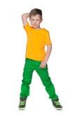 Zadumana chłopiec w żółtej koszula obrazy royalty free