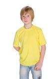 Zadumana chłopiec w żółtej koszula Zdjęcia Stock