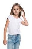 Zadumana mała dziewczynka z bieżącym włosy obraz stock
