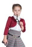Zadumana mała dziewczynka z szkłami zdjęcia stock