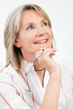 zadumana starsza uśmiechnięta kobieta Fotografia Royalty Free