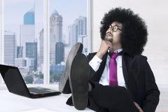 Zadumany Afro biznesmen blisko okno Obraz Royalty Free