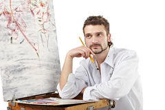 Zadumany artysta wynajdowć nowego wizerunek Odizolowywający nad bielem Obrazy Stock