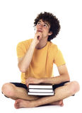 Zadumany nastolatek z książkami. Obrazy Royalty Free
